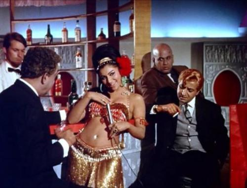 A leering Pran gets an eyeful of Sharmila Tagore in 1967's An Evening In Paris. Click for image.