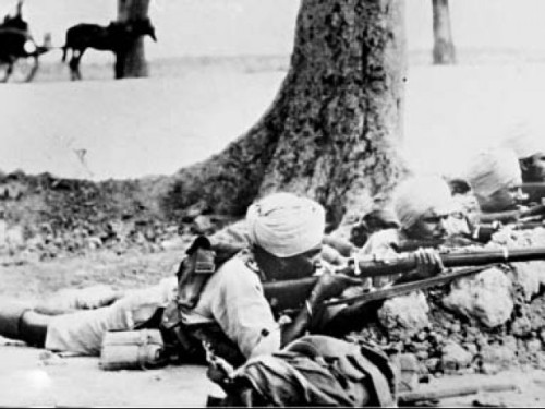 Archive photos: A sepoy taking aim early in the day    Image source - INP; courtesy - tribune.com.pk   Click for image.