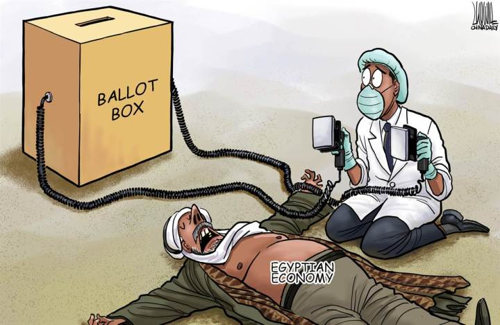 A ballot box as a defibrillator?  Revive the Egyptian economy?  |  Cartoon by Luojie from China, Politicalcartoons.com  |  Click for image.