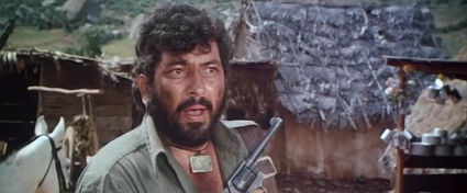 Amjad Khan as Gabbar Singh in Sholay; a tale of hapless villagers pitted against armed bandits.