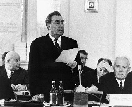 June 7, 1969: Soviet Communist Party leader Leonid Brezhnev addresses the World Conference of Communist Parties in Moscow. In his speech, Brezhnev accused Red China of planning nuclear and conventional war against the Soviet Union. USSR Premier Alexei Kosygin, left, and President Nikolai Podgorny listen to his statement. | Photos: Bettmann/CORBIS; source: wired.com | Click for image.